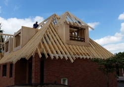 Traditional cut roof being fitted to new dormer bungalow